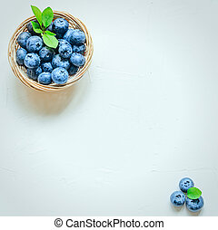 Fresh blueberries on white background. Top view, copy space