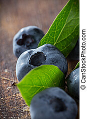 Fresh Blueberries on wooden table.