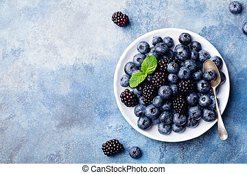 Fresh blueberry and blackberry berries. Top view