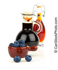 fresh blueberry and blueberry syrup in glass, bottle or mixture, on white background