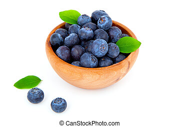 fresh blueberry in a wooden bowl with leaves, over a white background.