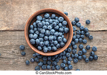 Fresh Blueberry on wooden background, close up