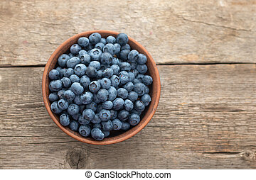 Fresh Blueberry on wooden background, top view.
