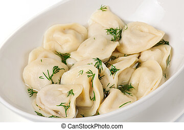 Fresh boiled meat dumplings served with dill