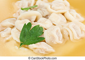 fresh boiled meat dumplings served with parsley