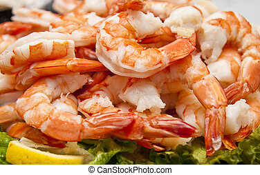 Fresh Boiled Shrimp and Lemon Slice - A platter of fresh...