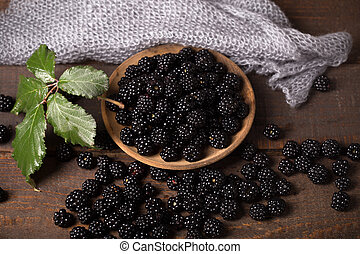 fresh bramble - blackberry with leaf over wooden background