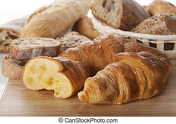 Fresh bread and croissants - Close up of fresh bread and ...