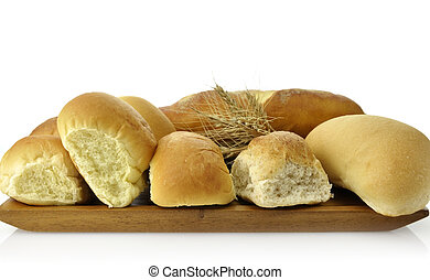 Fresh Bread Assortment On A Wooden Board, Close Up