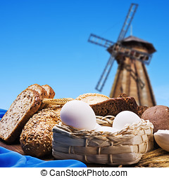 fresh bread on the background of the wooden mill