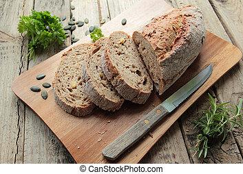 Fresh bread on wooden cutting board