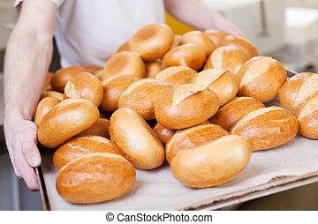 Fresh bread rolls in the bakery