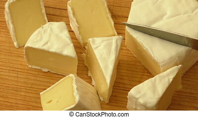Fresh brie cheese with white mold