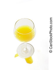 fresh brightly yellow orange juice in glass on a white background