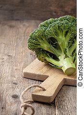 Fresh broccoli on a cutting board