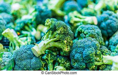 Fresh broccoli put up for sale in supermarket.