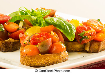 Fresh bruschetta with mixed tomatoes cheese and basil on plate