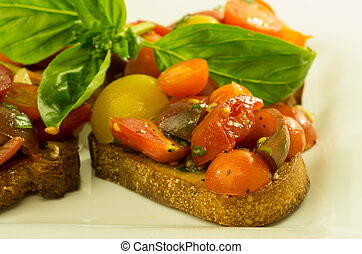 Fresh bruschetta with mixed tomatoes cheese and basil