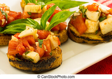 Fresh bruschetta with tomatoes cheese and basil