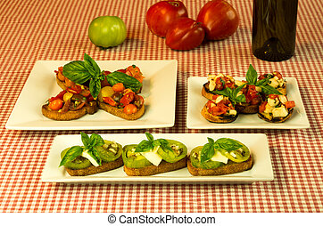 Fresh bruschetta with tomatoes cheese basil and wine bottle