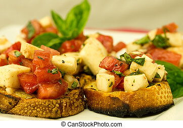 Fresh bruschetta with tomatoes mozzarella cheese and basil