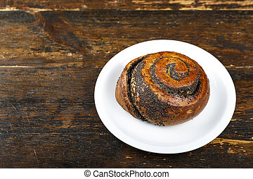 bun with poppy seeds in a plate