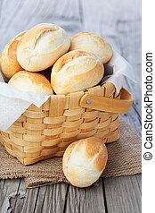 Fresh buns - Homemade fresh buns in a basket on old wooden ...