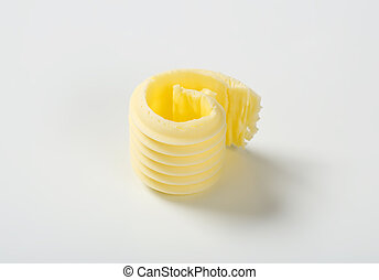 fresh butter curl on white background