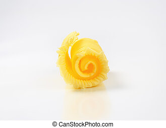 fresh butter curl - Curl of fresh butter on white background