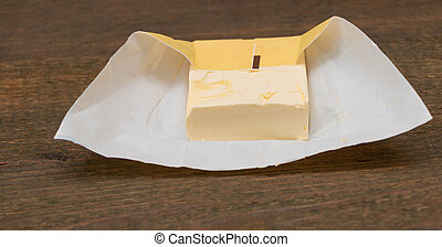 Fresh butter on a wooden background close up