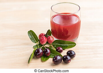 fresh Carissa carandas glass of juice with Carissa carandas fruits and Healthy drinks concept