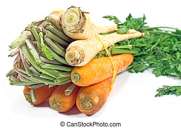 Fresh carrot and parsley with root on white