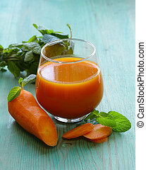 fresh carrot juice in glass