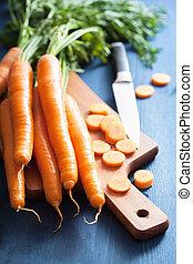 fresh carrot on cutting board