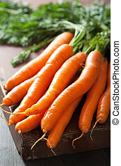 fresh carrot over wooden background