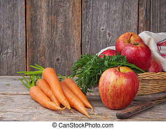 Fresh carrots and apples