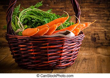 fresh carrots bunch in basket