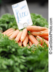 Fresh carrots for sale with a price-tag