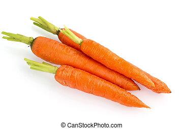 fresh carrots - organically grown carrots lying on white...
