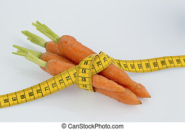 fresh carrots with measure tape - carrots from organic...