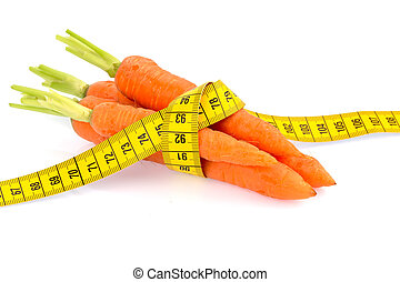 fresh carrots with tape measure - organically grown carrots ...