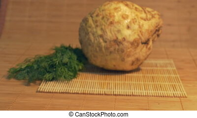 Fresh Celery Root on Table - Sliding to fresh celery in the...