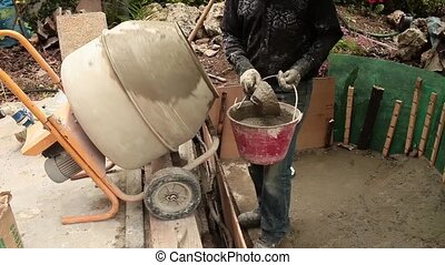 Fresh Cement - Video clip of mason taking fresh cement from...
