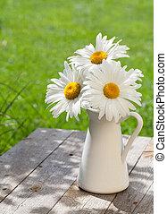 Fresh chamomile bouquet in vase