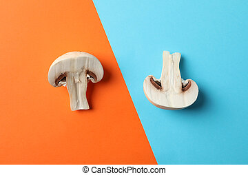 Fresh champignon mushrooms on two tone background, top view