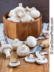 Fresh champignon mushrooms on cutting board