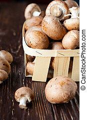 fresh champignons in a basket
