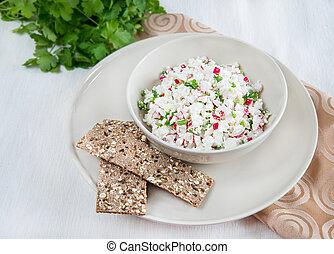 Fresh cheese salad with radish and herbs