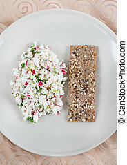 Fresh cheese salad with radish and herbs on plate