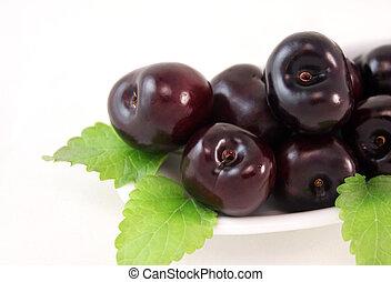 Fresh cherries on a plate